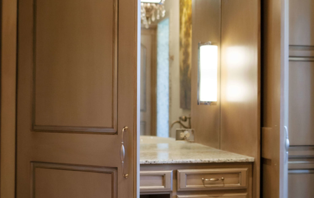 bathroom vanity and mirror entrance